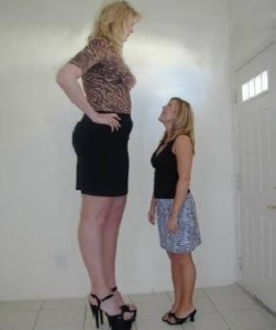 Two women. One of whom is much taller than the other.