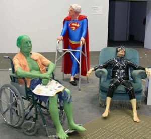 Three very old people are dressed as Superman, the Incredible Hulk and Cat Woman.