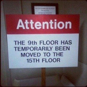 A warning notice which says that the ninth floor has been temporally moved to the fifteenth floor.