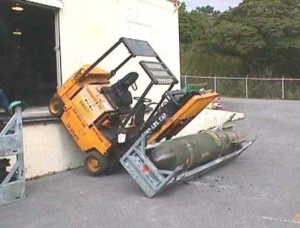 Crashed fork-lift truck carrying a bomb.