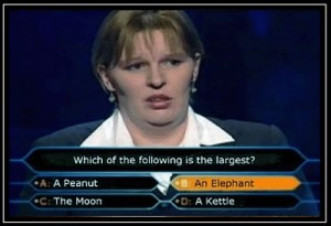 A woman on a TV quiz show is answering questions containing articles a, an and the.