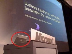 An Apple laptop is being used in a presentation given by Microsoft.
